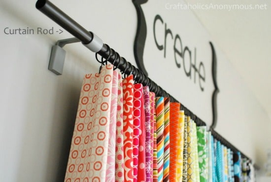 How to store fabric - Use a curtain rod and clip rings