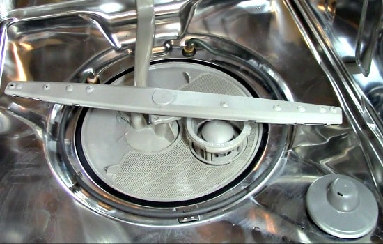 How to clean a dishwasher - Inspect and clean the filters