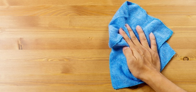 Weekly bedroom cleaning checklist - Dust wood surfaces before polishing