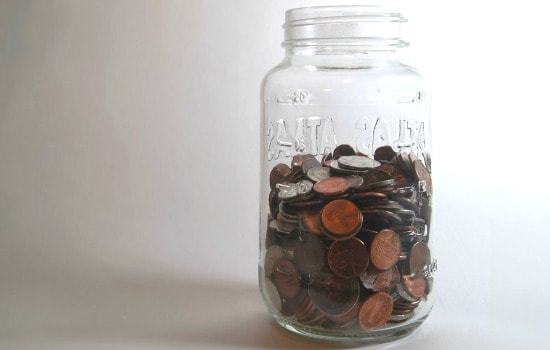 How to save money on school supplies - Get the kids to contribute with a savings jar