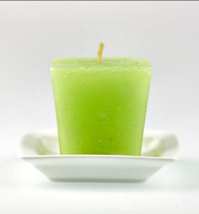 How to Get Candle Wax out of Carpet - Green apple candle in a white tray