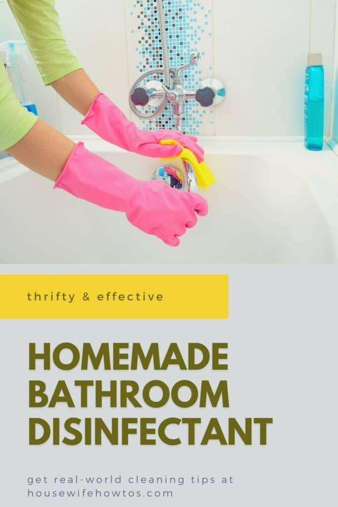 Woman wearing rubber cleaning gloves uses a sponge to polish a bathtub faucet sprayed with homemade bathroom disinfectant