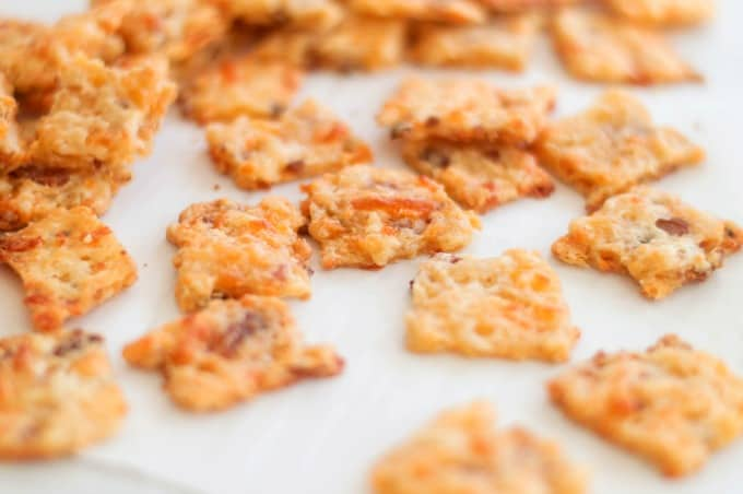 Bacon Garlic Cheddar Crackers ready to eat on a white plate