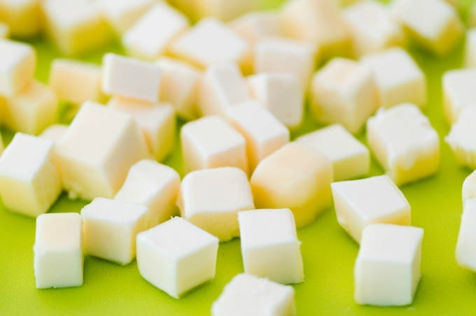 Cubes of butter to be used in bacon garlic cheddar crackers recipe