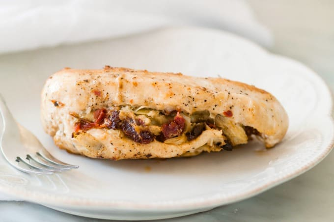 Mediterranean Stuffed Chicken Breasts filled with sundried tomatoes and homemade marinated artichoke hearts