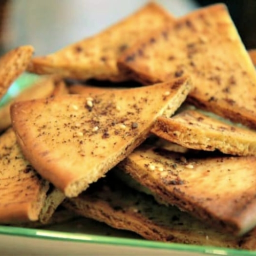 Easy homemade pita chips recipe served on a plate