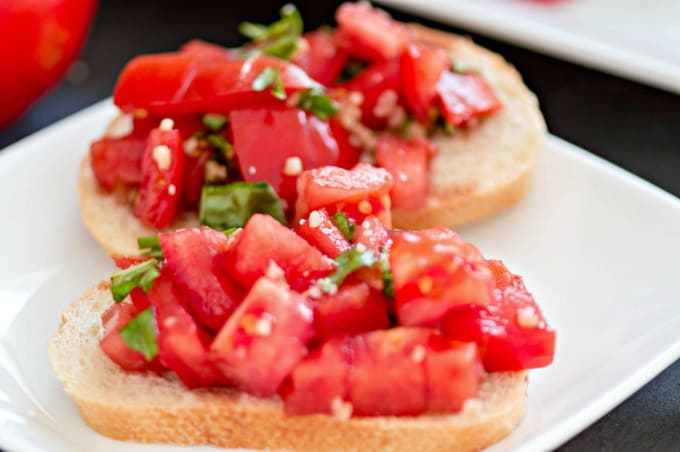 Two servings of this Bruschetta Recipe on a white plate