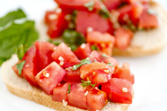 Fresh chopped tomatoes, garlic, and herbs on toasted bread are the essentials in this Bruscetta Recipe