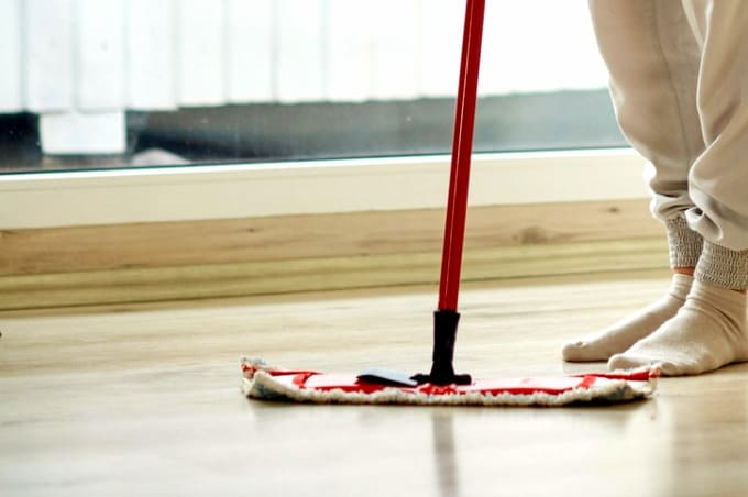 Homemade Floor Cleaner Recipe A Person And Mop Standing On Shiny Clean