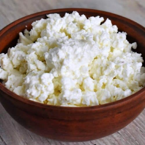 Homemade Cottage Cheese in Wood Bowl on tabletop