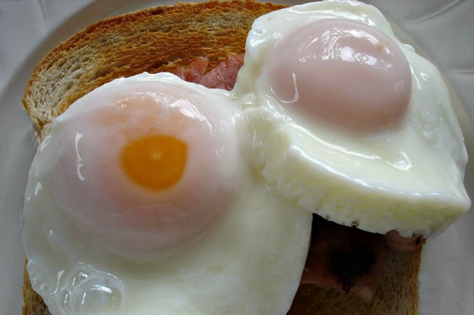 How to Poach an Egg in the Microwave - Toast topped with two perfectly poached eggs