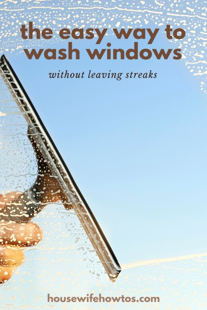"""Hand using a squeegee to clean a window. Text overlay reads: """"the easy way to wash windows without leaving streaks"""""""