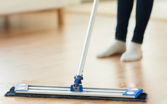 How to clean wood floors - Dust mop them regularly