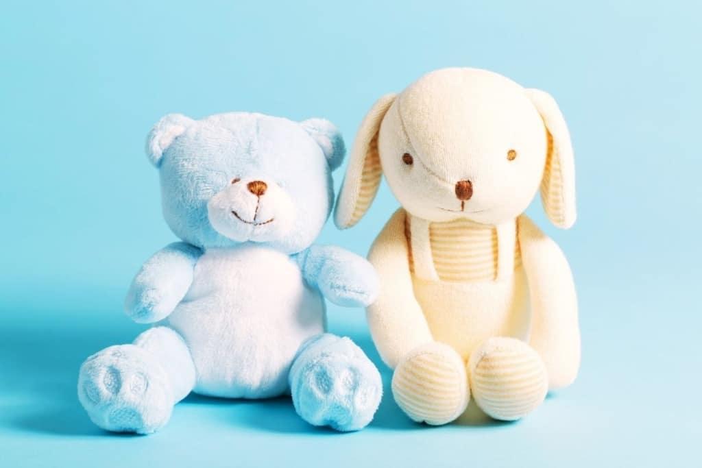 Stuffed teddy bear and plush dog toy