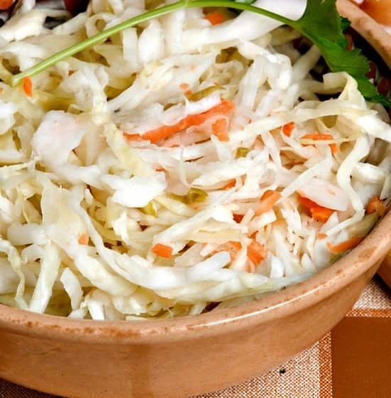 Grated cabbage and carrots for coleslaw