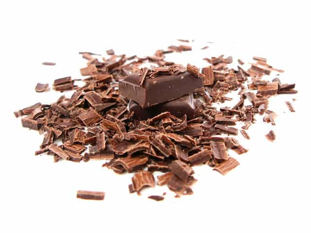 Grated chocolate bar on a white background