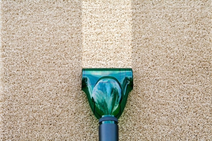 Upholstery attachment of carpet shampooer shows how to steam clean carpeting