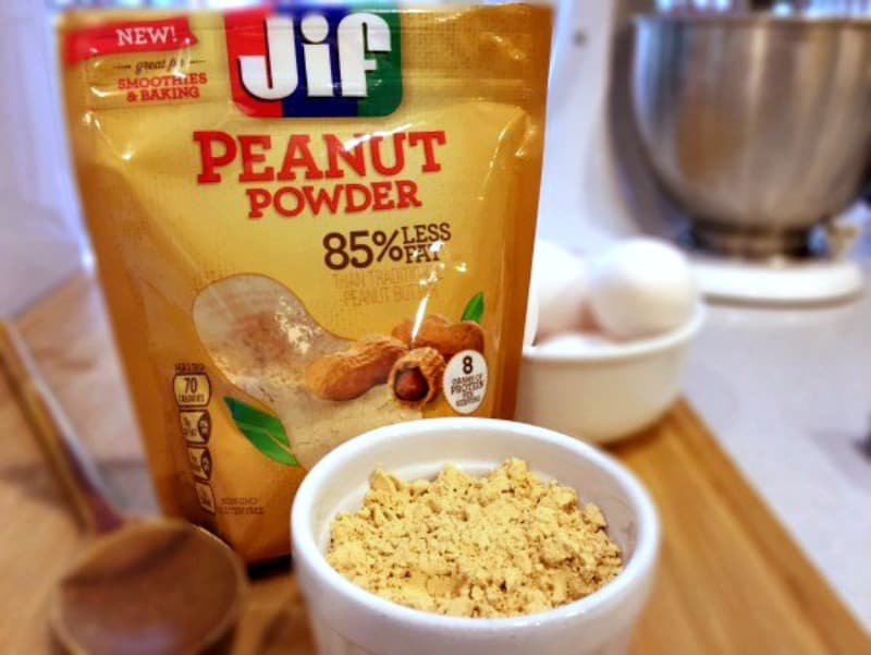 Jif Peanut Powder and eggs on a kitchen counter to make Peanut Butter Chocolate Swirl Cupcakes