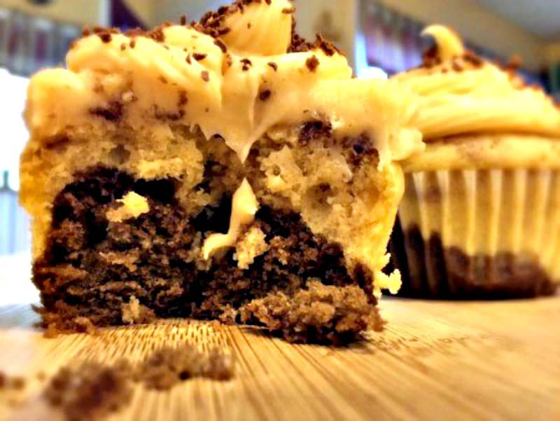 Peanut Butter Frosting dripping down front of Peanut Butter Chocolate Swirl Cupcake