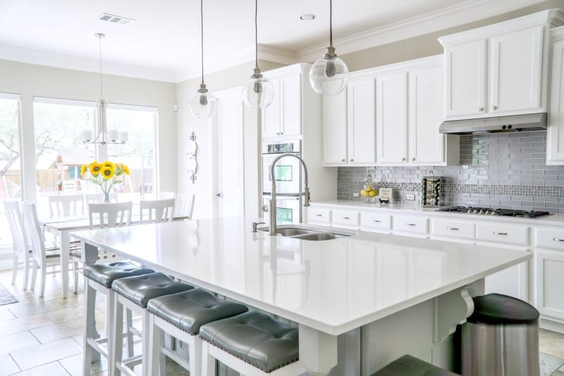 Clean modern kitchen with spotless counters after using DIY Granite Cleaner Recipe