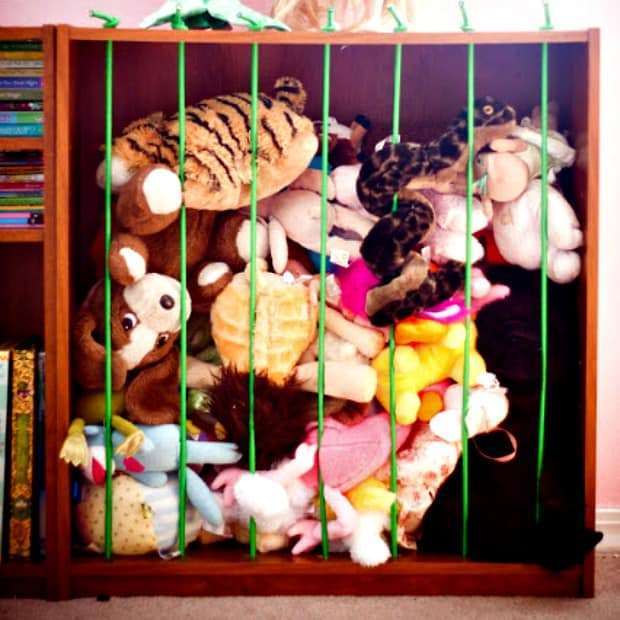 How to organize toys: Corral stuffed animals with bungee cords