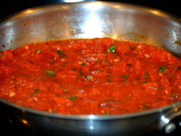 Easy Marinara Sauce Recipe - Stir fresh herbs into sauce after removing from heat