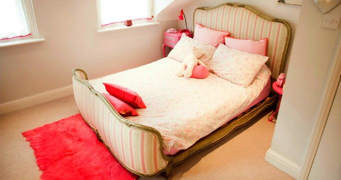 Help Kids Organize Their Rooms - Girl's bedroom with pink and white bedding