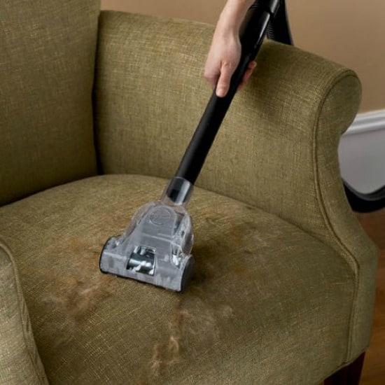Cleaning upholstered furniture with vacuum attachment