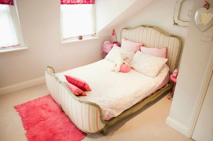 Clean girls pink and white bedroom as part of the cleaning checklist for kids' rooms