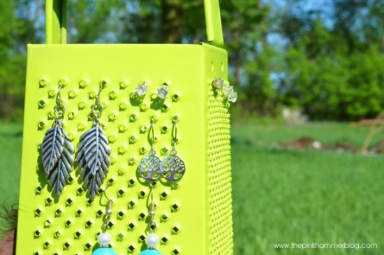 Cheese grater spray-painted and turned into jewelry organizer