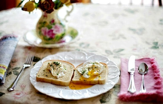 Eggs on toast served at a beautifully laid table