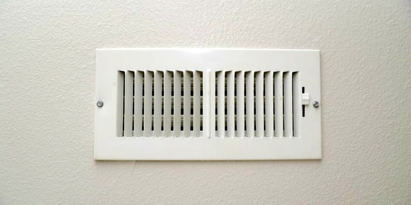 How to Clean Your Own Air Ducts - Air register on a wall