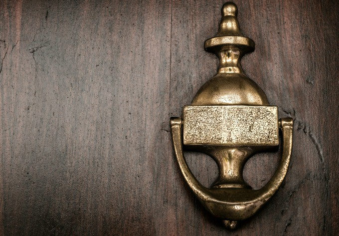 Cleaning Mistakes That Lower Home Value - Not polishing front door hardware