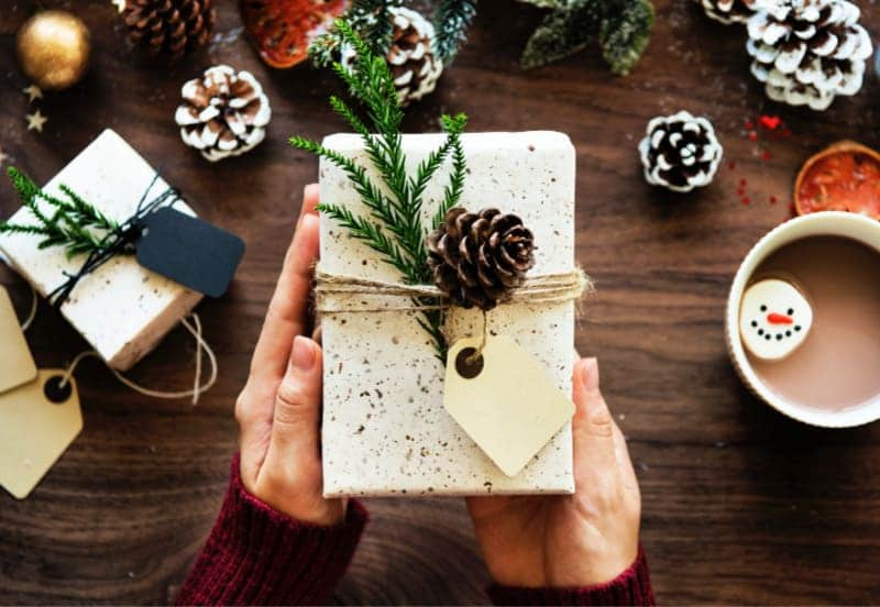 How to Avoid Holiday Stress - Christmas Gift wrapped in simple paper with tag