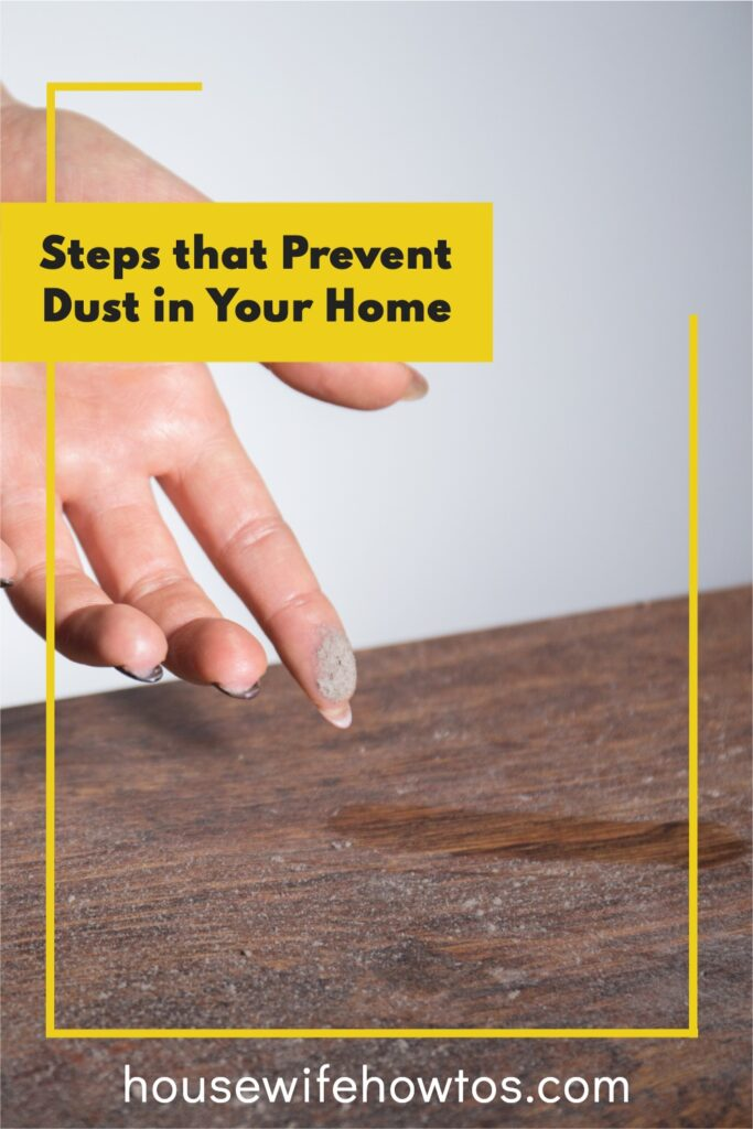 """Closeup of female fingertip with dust on it and a dusty tabletop with a text overlay that reads """"Steps that Prevent Dust in Your Home"""""""