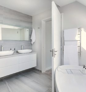 Tips to Deep Clean a Bathroom - Sparkling white bathtub and modern bathroom vanity