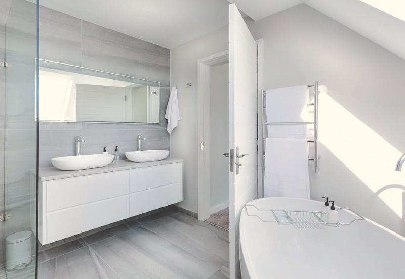 Tips to Deep Clean a Bathroom - Sparkling white bathtub and modern bathroom vanity