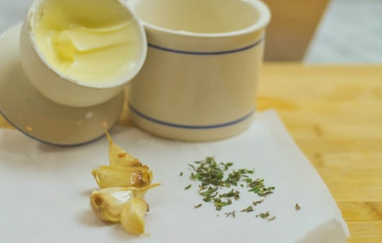 Roasted Spring Vegetables Recipe - Combine roasted garlic with thyme and softened butter