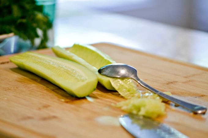 Peel and scoop seeds out of cucumber