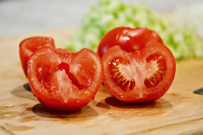 Remove seeds from tomatoes and pat dry