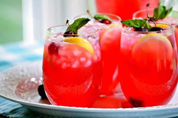 Boozy Fresh Cherry Lemonade - Serve garnished with mint and fruit