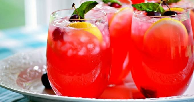 Boozy Fresh Cherry Lemonade with or without liquor is the perfect drink for hot summer days