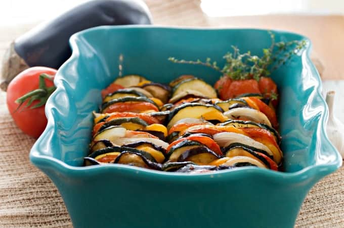 Ratatouille With Fresh Basil Cream Recipe - Keep vegetables vibrant by covering them with parchment in the oven