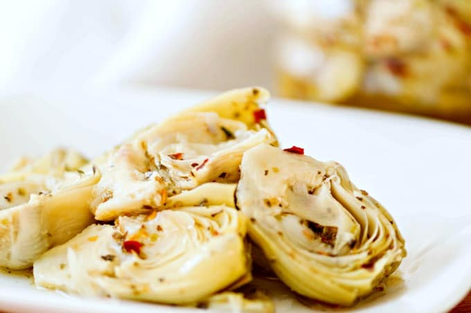 Homemade Marinated Artichoke Hearts sitting to let flavors meld