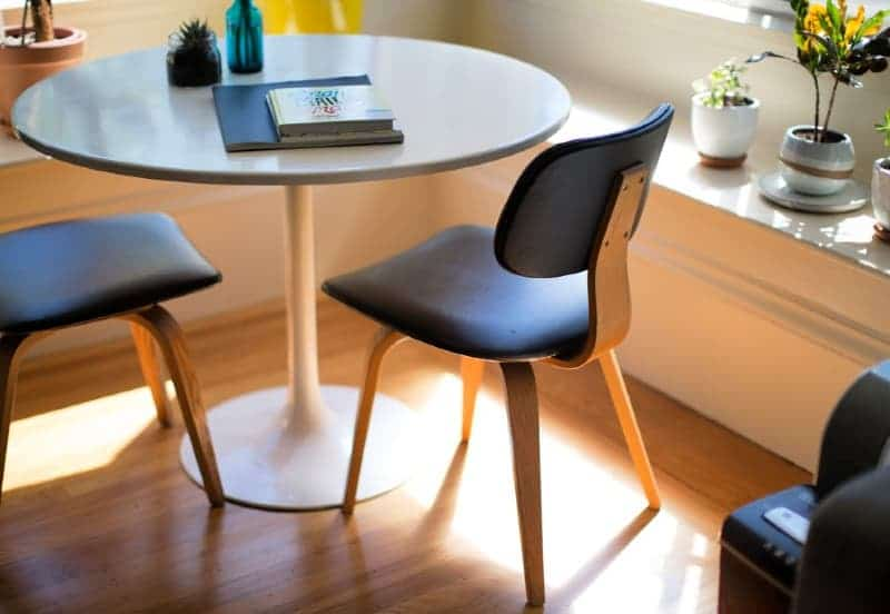 Modern round dining table and chairs in a clean and organized house