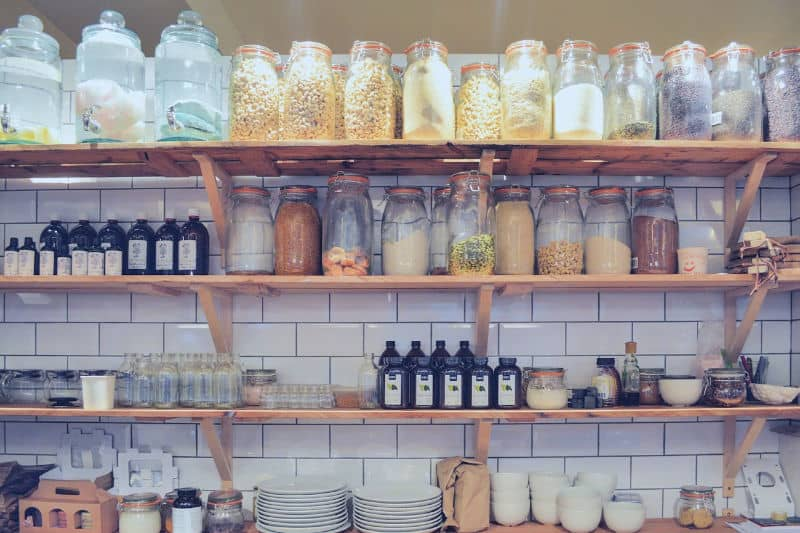 Organizing Tips to Keep Clutter Away - Open shelves with food in jars