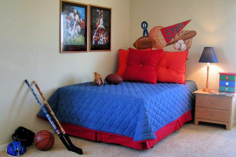 Organizing Kids' Bedrooms - Tidy and clean boys bedroom with sports decor theme