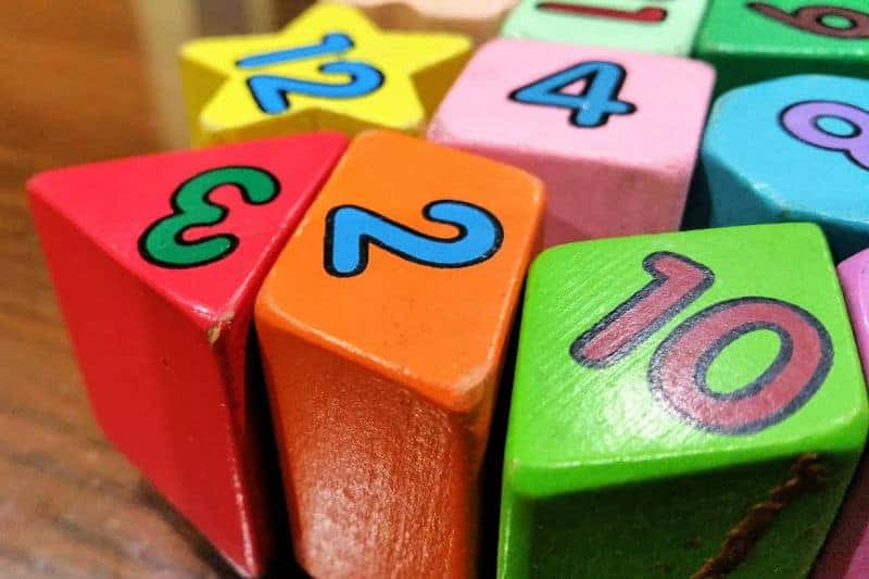 Organizing Kids Toys - Colorful wooden blocks with numbers painted on them