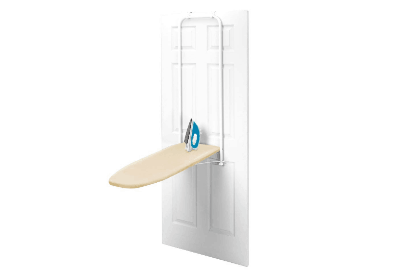 Organizing the Laundry Room - An ironing board hanging on the back of the door