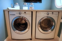Organizing the Laundry Room - front load washer and dryer with countertop